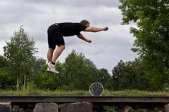 Sportowiec i zegar Zdjęcia Stock