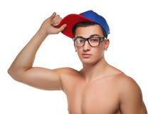 Sportowy facet w szkłach i nakrętce Obraz Stock