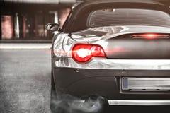 Sportowy Samochód, tylni widok, wydmuchowa drymba Zdjęcia Stock
