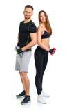 Sportpaar - man en vrouw met domoren op het wit Stock Foto
