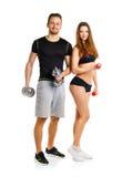 Sportpaar - man en vrouw met domoren op het wit Royalty-vrije Stock Foto