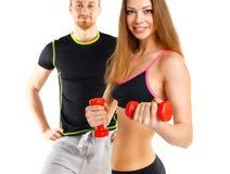 Sportpaar - man en vrouw met domoren op het wit Royalty-vrije Stock Afbeelding