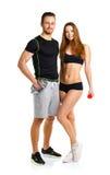 Sportpaar - man en vrouw met domoren op het wit Stock Afbeeldingen