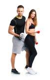 Sportpaar - man en vrouw met domoren op het wit Royalty-vrije Stock Afbeeldingen