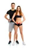 Sportpaar - man en vrouw met domoren op het wit Stock Fotografie