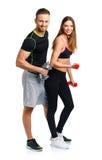 Sportpaar - man en vrouw met domoren op het wit Stock Afbeelding