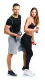 Sportpaar - man en vrouw met domoren op het wit Royalty-vrije Stock Foto's