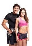 Sportpar - man och kvinna med hantlar på viten royaltyfri bild