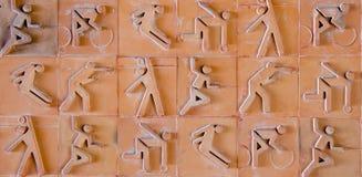 Sportpiktogramm Sportikone eingestellt auf Töpferwarenziegelstein Stockbilder