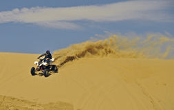 Sportquad in sand Royalty Free Stock Photo