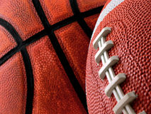 Sports. Football and basketball close up and focus on the football Royalty Free Stock Image
