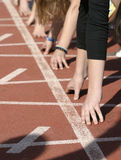 Sports 9. Close up of hands on starting line Royalty Free Stock Image