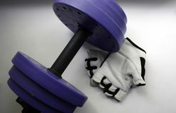 Sports accessories. Dumbbells, gloves, on a white background. Top view with copy space. Fitness, sport and healthy lifestyle. Concept. Close-up, christmas royalty free stock images