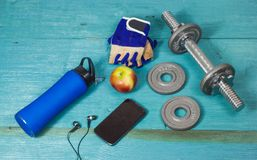 Sports accessories for fitness on the blue floor Stock Photos