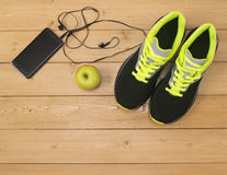 Sports accessories for fitness on the wooden floor. royalty free stock photos