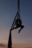 Female acrobat in the air on the hammock. Sports acrobatics on a hammock in the air Stock Image
