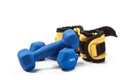 Sports activities for hands. Dumbbells and weight for wrists on a white background Royalty Free Stock Images