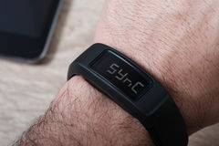 Sports Activity Tracker Wristband. With Simulated Syncing to mobile device Stock Photography