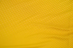 Sports apparel fabrics. ,Yellow, breathable Royalty Free Stock Photo