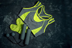 Sports apparel. Unusual skipping rope with balls instead of ropes and socks on a dark cement background .Sport and healthy lifestyle concept. Clothing Royalty Free Stock Photos
