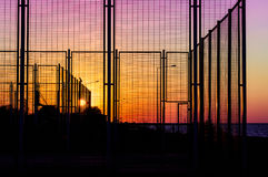 Sports Area Fences On The Sunset Stock Images