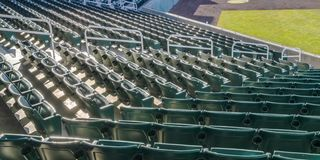 Sports arena with tiers of sunlit empty seats royalty free stock photos