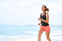 Free Sports. Athlete Jogging On Beach. Fitness, Exercising, Healthy L Royalty Free Stock Photos - 64577888