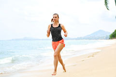 Free Sports. Athlete Jogging On Beach. Fitness, Exercising, Healthy L Royalty Free Stock Images - 64577889