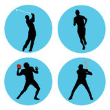 Sports Athletes. Sports athlete silhouettes in blue circles Royalty Free Stock Photos