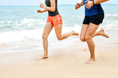 Sports. Athletic Runners Legs Running On Beach. Workout. Healthy Stock Photo