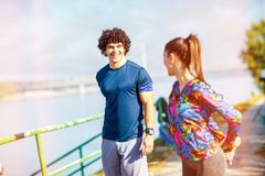 Sports attractive couple getting ready to run and exercise outdoors royalty free stock images
