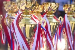 Sports awards cups and medals at competitions. Prizes awarded champions of sports competitions. Cup and Bedal. Sports awards cups and medals at competitions stock photos