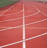 Sports background. Red running track at arena stock photo