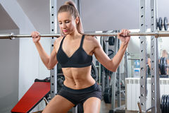 Sports background. Muscular fit woman exercising. Stock Photography