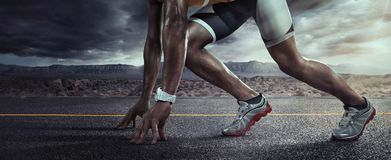 Sports background. Runner feet running on road closeup on shoe. royalty free stock image