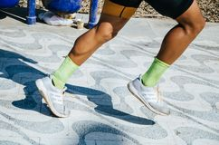 Sports background. Runner feet royalty free stock photo