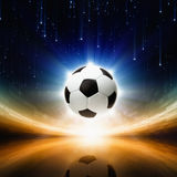 Soccer ball, bright light. Sports background - soccer ball, bright light, abstract stadium, arena Stock Photo