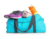 Sports bag and gym stuff. On white background royalty free stock photography