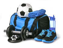Sports bag with sports equipment. On white with clipping path Royalty Free Stock Photo