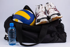Sports bag with sportswear and ball. Stock Photography