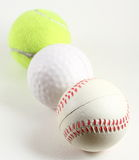 Sports Balls. The three major sports balls represent golf, tennis and baseball Royalty Free Stock Images