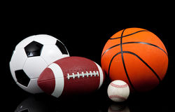 Sports balls on a black background Royalty Free Stock Photo