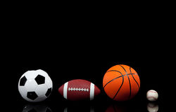 Sports balls on a black background Royalty Free Stock Images