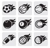 Sports balls on fire. Vector black sports balls on fire on gray Royalty Free Stock Photos