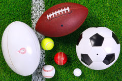 Sports balls on grass from above. Stock Photography