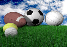 Sports balls on grass - horizontal Royalty Free Stock Images