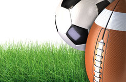 Sports balls on a green grass Stock Images