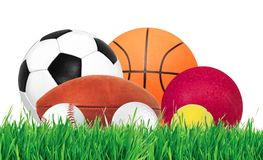 Sports balls over green grass isolated on white. Background royalty free stock photos