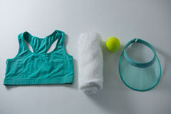 Sports bar with napkin and tennis ball by sun visor. On white background Royalty Free Stock Photo