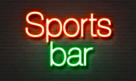 Sports bar neon sign on brick wall background. Royalty Free Stock Image